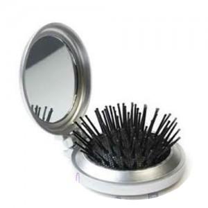 Cepillo de viaje con espejo